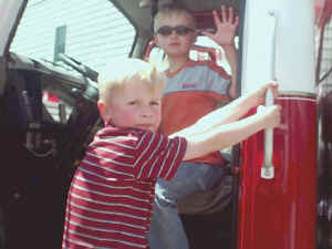 Kyle Tyler and Caleb Evans explore a fire truck at the Ewell Volunteer Fire Company open house
